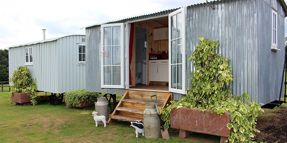 Shepherd Huts and Cabins With Cows & Sheep